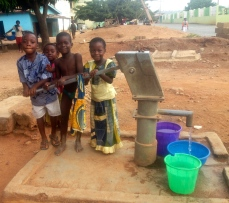 Local kids collecting water from the well.